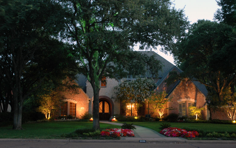 Landscape lighting installed on a home in Highland Park neighborhood of Dallas, TX