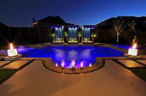 Dallas Landscape Lighting wired the electrical components and lighting/fire features for this Hauk Custom Pools customer in Allen, TX
